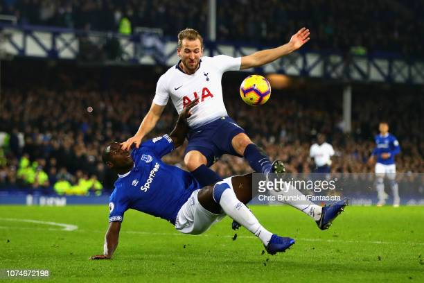 Harry Kane of Tottenham Hotspur is challenged by Kurt Zouma of Everton during the Premier League match between Everton FC and Tottenham Hotspur at...