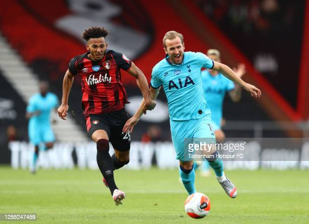 Harry Kane of Tottenham Hotspur is challenged by Lloyd Kelly of AFC Bournemouth during the Premier League match between AFC Bournemouth and Tottenham...