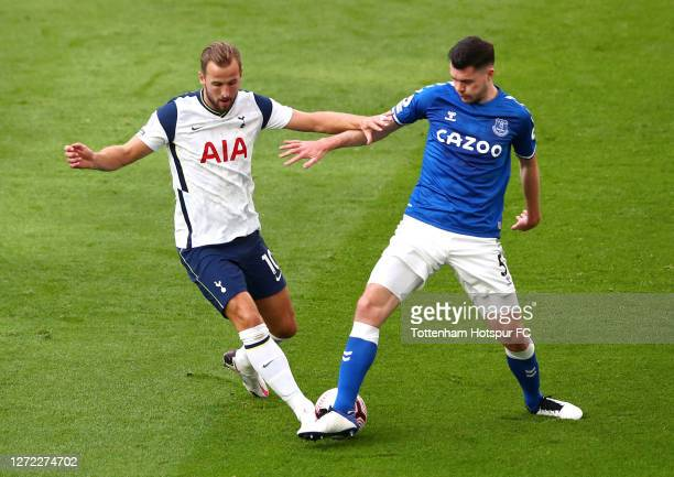 Harry Kane of Tottenham Hotspur is challenged by Michael Keane of Everton during the Premier League match between Tottenham Hotspur and Everton at...