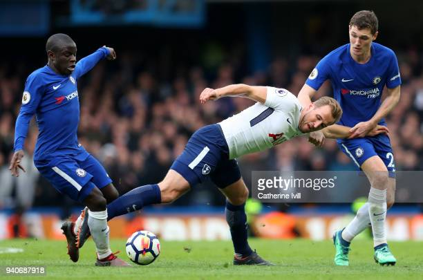Harry Kane of Tottenham Hotspur is challenged by N'Golo Kante of Chelsea and Andreas Christensen of Chelsea during the Premier League match between...