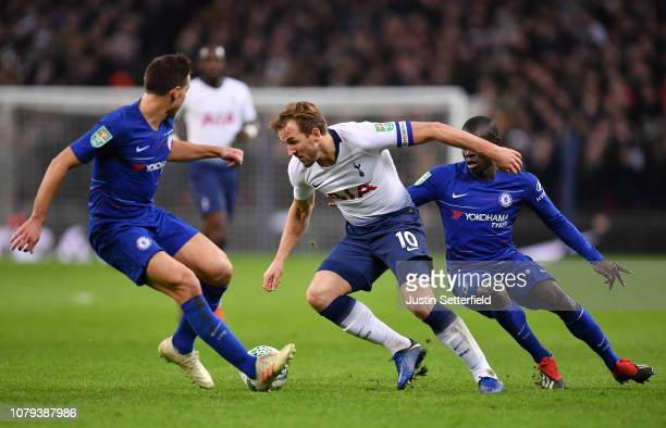 Harry Kane of Tottenham Hotspur is challenged by N'golo Kante of Chelsea during the Carabao Cup SemiFinal First Leg match between Tottenham Hotspur...