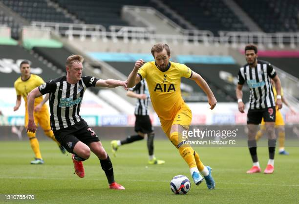 Harry Kane of Tottenham Hotspur is challenged by Sean Longstaff of Newcastle United during the Premier League match between Newcastle United and...