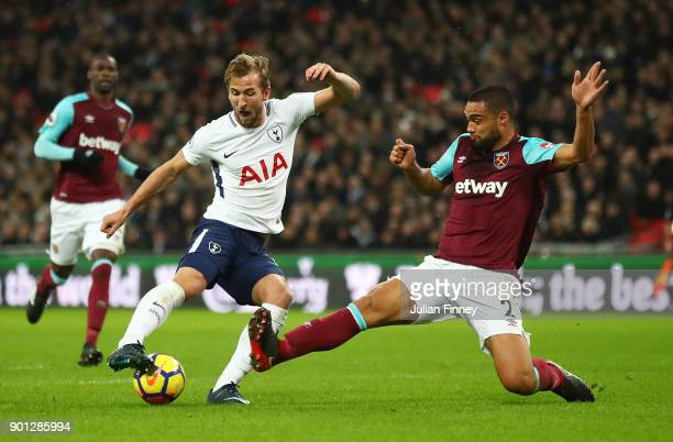 Harry Kane of Tottenham Hotspur is challenged by Winston Reid of West Ham United during the Premier League match between Tottenham Hotspur and West...