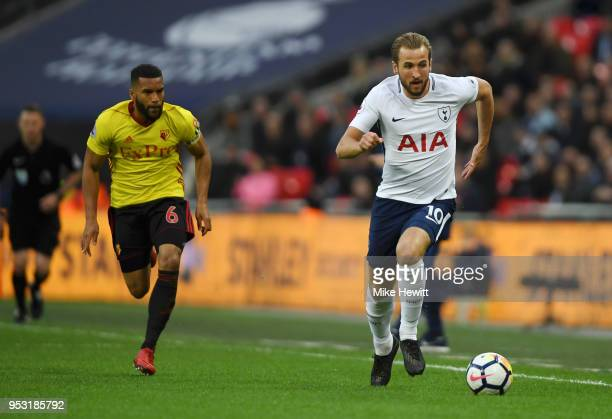Harry Kane of Tottenham Hotspur is chased down by Adrian Mariappa of Watford during the Premier League match between Tottenham Hotspur and Watford at...