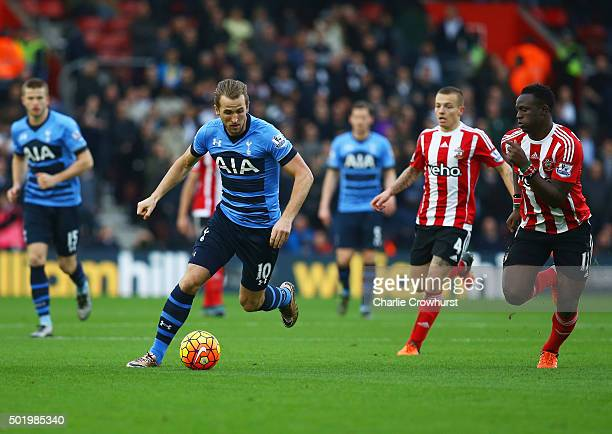 Harry Kane of Tottenham Hotspur is chased Jordy Clasie and Victor Wanyama of Southampton during the Barclays Premier League match between Southampton...