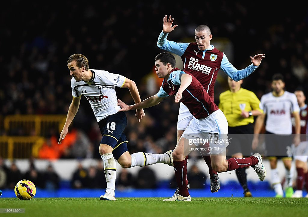 Harry Kane of Tottenham Hotspur is closed down by Michael Keane of Burnley during the Barclays Premier League match between Tottenham Hotspur and Burnley at White Hart Lane on December 20, 2014 in London, England.