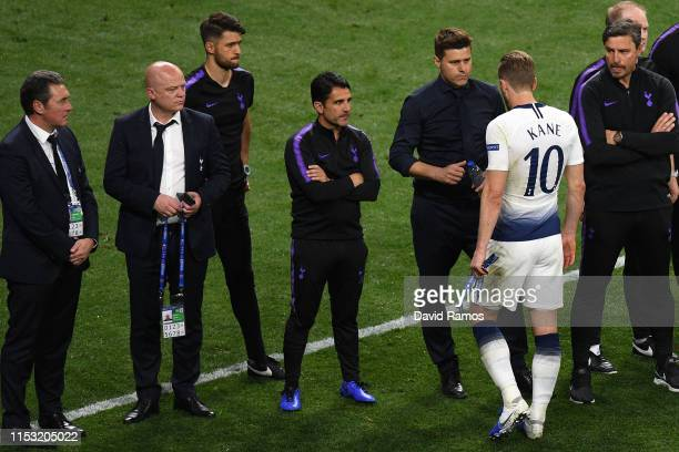 Harry Kane of Tottenham Hotspur is comforted by his manager Mauricio Pochettino at the end of the UEFA Champions League Final between Tottenham...