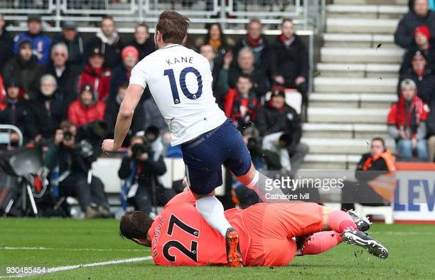 Harry Kane of Tottenham Hotspur is fouled by Asmir Begovic of AFC Bournemouth during the Premier League match between AFC Bournemouth and Tottenham...