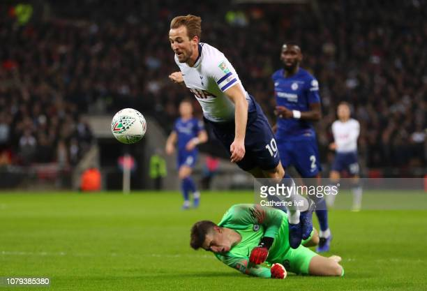 Harry Kane of Tottenham Hotspur is fouled by Kepa Arrizabalaga of Chelsea and a penalty is later awarded through VAR during the Carabao Cup SemiFinal...