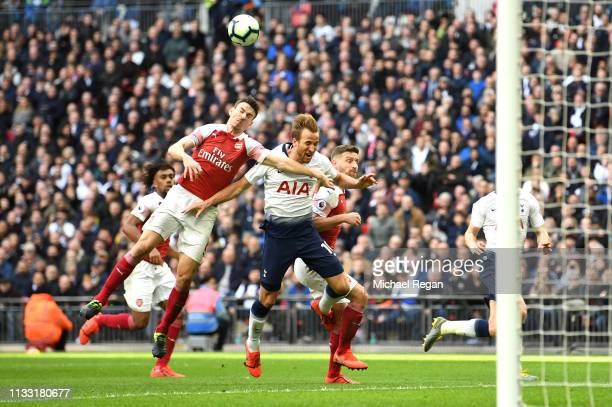 Harry Kane of Tottenham Hotspur is fouled by Shkodran Mustafi of Arsenal resulting in a penalty during the Premier League match between Tottenham...