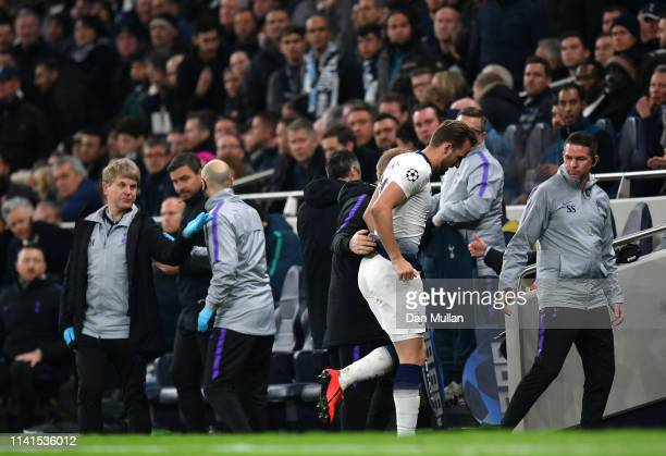 Harry Kane of Tottenham Hotspur is helped down the tunnel after going down injured during the UEFA Champions League Quarter Final first leg match...
