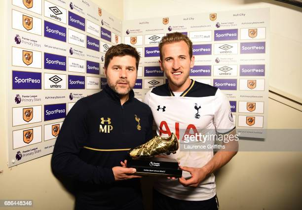 Harry Kane of Tottenham Hotspur is presented the Premier League Golden Boot award by manager Mauricio Pochettino after the Premier League match...