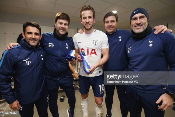 Harry Kane of Tottenham Hotspur is presented with a pair of celebratory Nike boots with assistant manager Jesus Perez manager mauricio Pochettino...