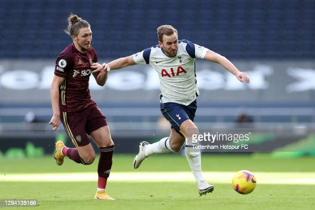 Harry Kane of Tottenham Hotspur is put under pressure by Luke Ayling of Leeds United during the Premier League match between Tottenham Hotspur and...