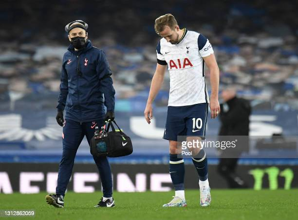 Harry Kane of Tottenham Hotspur is substituted off following an injury during the Premier League match between Everton and Tottenham Hotspur at...
