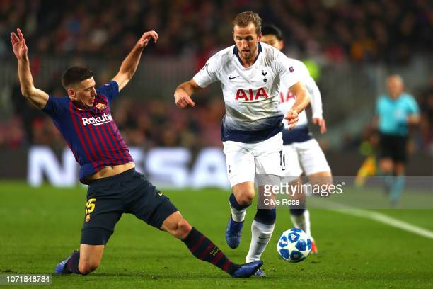 Harry Kane of Tottenham Hotspur is tackled by Clement Lenglet of Barcelona during the UEFA Champions League Group B match between FC Barcelona and...