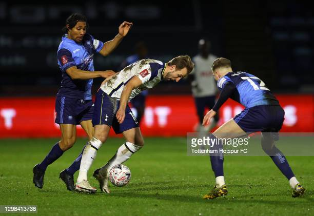 Harry Kane of Tottenham Hotspur is tackled by Darius Charles and Josh Knight of Wycombe Wanderers during The Emirates FA Cup Fourth Round match...