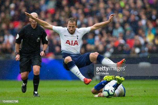 Harry Kane of Tottenham Hotspur is tackled by Harry Arter of Cardiff City during the Premier League match between Tottenham Hotspur and Cardiff City...