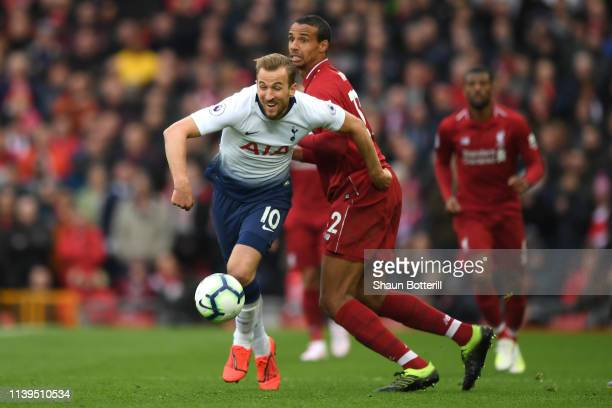 Harry Kane of Tottenham Hotspur is tackled by Joel Matip of Liverpool during the Premier League match between Liverpool FC and Tottenham Hotspur at...