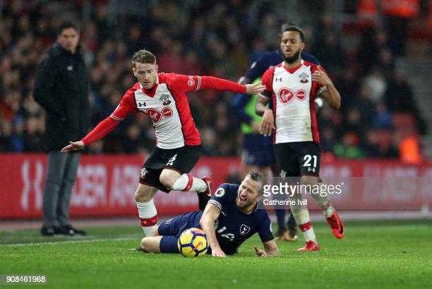 Harry Kane of Tottenham Hotspur is tackled by Steven Davis of Southampton during the Premier League match between Southampton and Tottenham Hotspur...