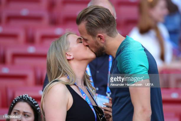 Harry Kane of Tottenham Hotspur kisses his fiance Katie Goodland during the Tottenham Hotspur training session on the eve of the UEFA Champions...