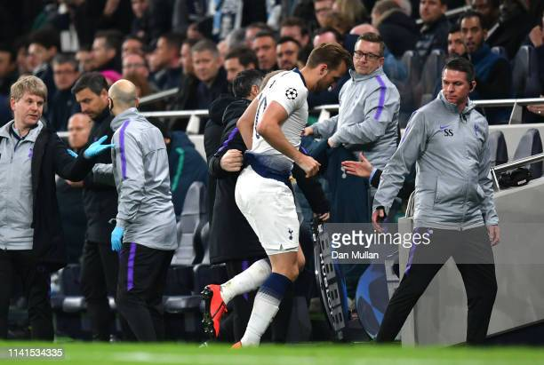 Harry Kane of Tottenham Hotspur limps off injured during the UEFA Champions League Quarter Final first leg match between Tottenham Hotspur and...