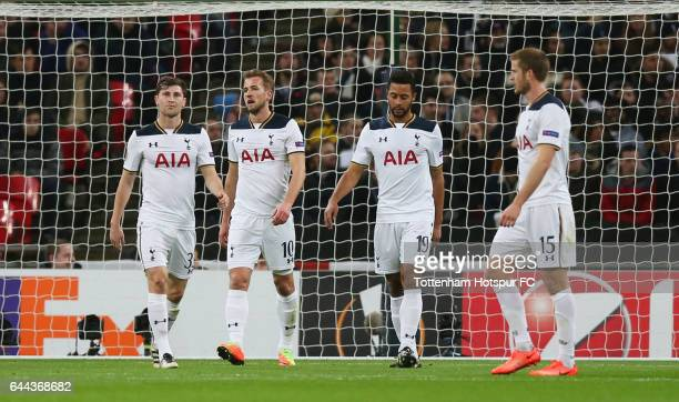 Harry Kane of Tottenham Hotspur looks dejected as he scores an own goal for Gent's first alongside team mates Ben Davies Mousa Dembele and Eric Dier...