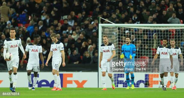 Harry Kane of Tottenham Hotspur looks dejected with team mates as he scores an own goal for Gent's first during the UEFA Europa League Round of 32...