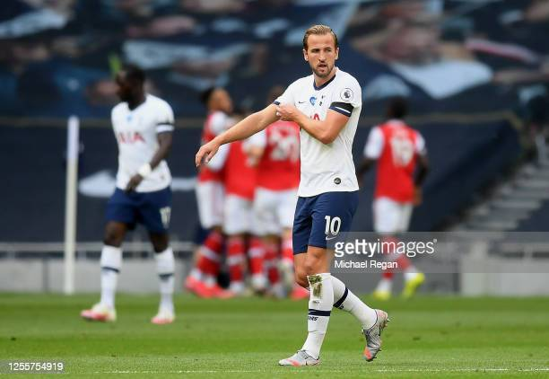 Harry Kane of Tottenham Hotspur reacts after Arsenal score their first goal of the game during the Premier League match between Tottenham Hotspur and...