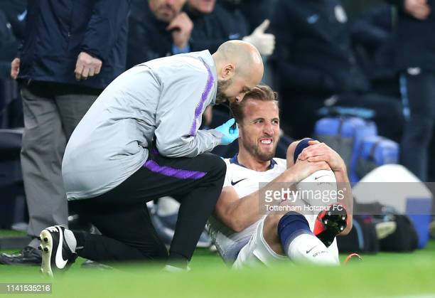 Harry Kane of Tottenham Hotspur reacts as he receives medical treatment during the UEFA Champions League Quarter Final first leg match between...