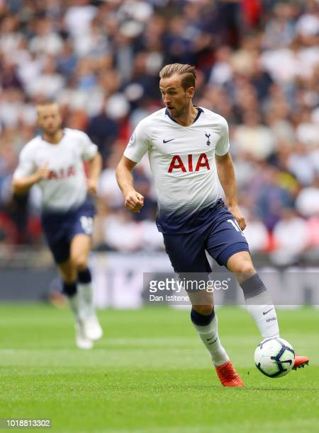 Harry Kane of Tottenham Hotspur runs with the ball during the Premier League match between Tottenham Hotspur and Fulham FC at Wembley Stadium on...