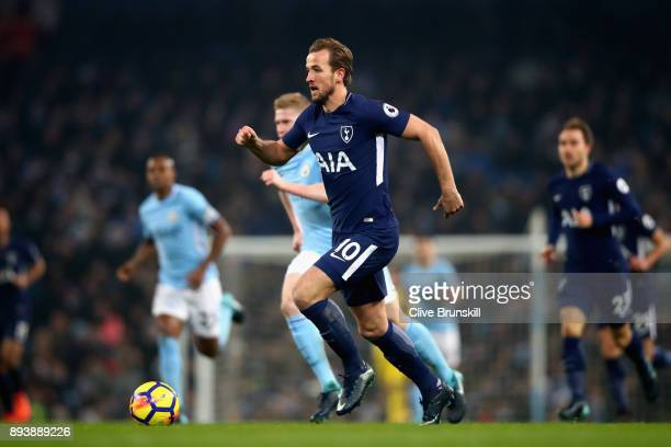 Harry Kane of Tottenham Hotspur runs with the ball during the Premier League match between Manchester City and Tottenham Hotspur at Etihad Stadium on...
