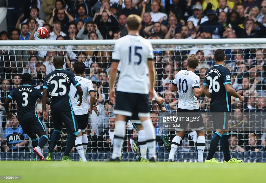 Harry Kane (2nd R) of Tottenham Hotspur scires his team's third goal during the Barclays Premier League match between Tottenham Hotspur and Manchester City at White Hart Lane on September 26, 2015 in London, United Kingdom.