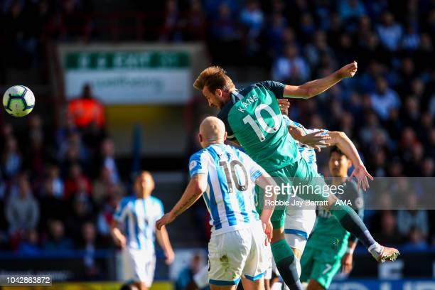 Harry Kane of Tottenham Hotspur scores a goal to make it 01 during the Premier League match between Huddersfield Town and Tottenham Hotspur at John...
