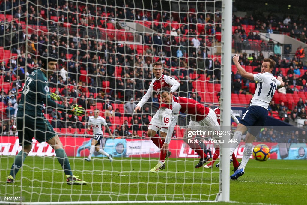 Harry Kane of Tottenham Hotspur scores a goal to make it 1-0 during the Premier League match between Tottenham Hotspur and Arsenal at Wembley Stadium on February 10, 2018 in London, England.