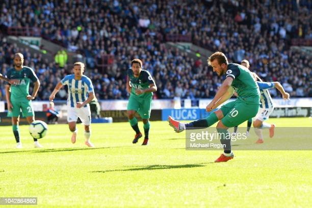 Harry Kane of Tottenham Hotspur scores a penalty for his sides second goal during the Premier League match between Huddersfield Town and Tottenham...