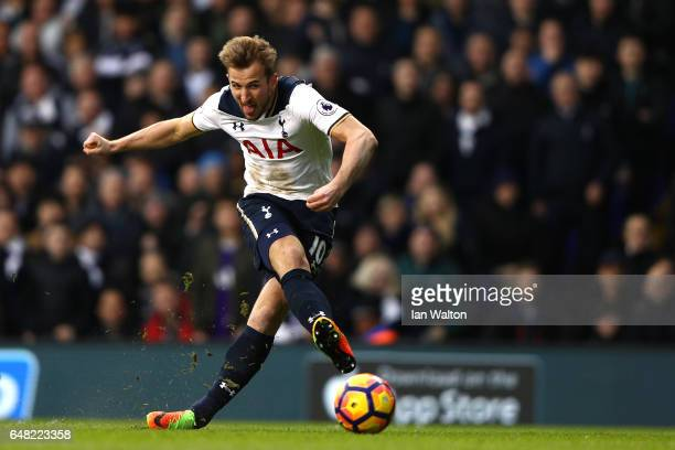 Harry Kane of Tottenham Hotspur scores his and his sides second goal during the Premier League match between Tottenham Hotspur and Everton at White...