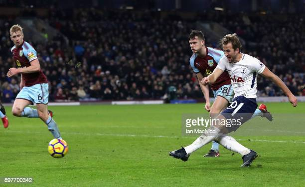 Harry Kane of Tottenham Hotspur scores his and his sides third goal during the Premier League match between Burnley and Tottenham Hotspur at Turf...