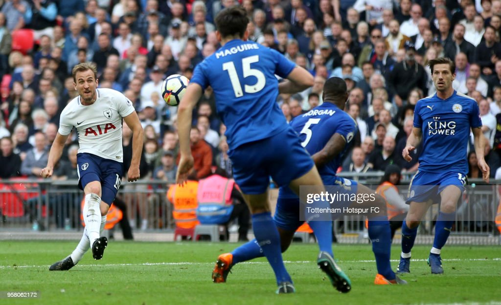 Harry Kane of Tottenham Hotspur scores his sides 5th goal during the Premier League match between Tottenham Hotspur and Leicester City at Wembley Stadium on May 13, 2018 in London, England.