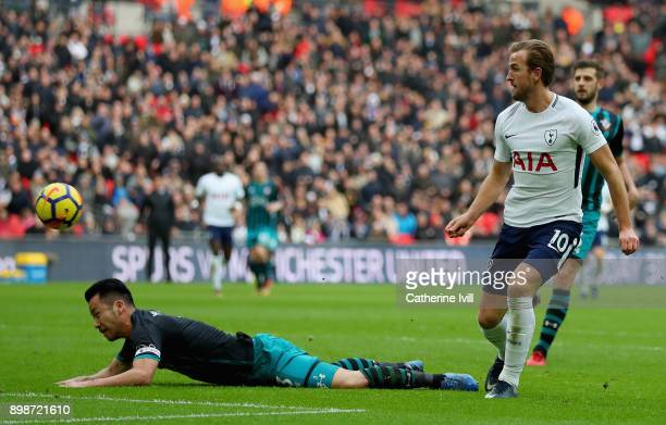 Harry Kane of Tottenham Hotspur scores his sides fifth goal as Maya Yoshida of Southampton attempts to tackle him during the Premier League match...