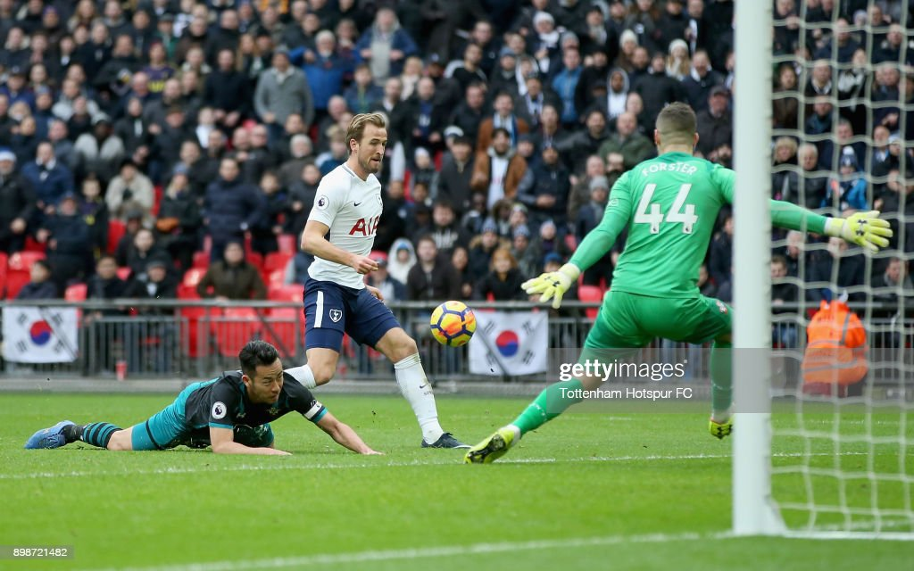 Harry Kane of Tottenham Hotspur scores his sides fifth goal past Fraser Forster of Southampton during the Premier League match between Tottenham Hotspur and Southampton at Wembley Stadium on December 26, 2017 in London, England.