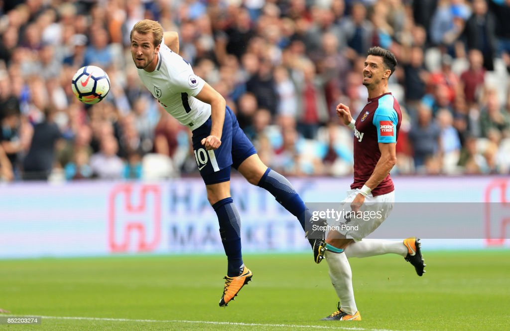 Harry Kane of Tottenham Hotspur scores his sides first goal during the Premier League match between West Ham United and Tottenham Hotspur at London Stadium on September 23, 2017 in London, England.