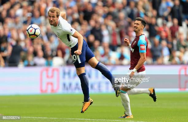 Harry Kane of Tottenham Hotspur scores his sides first goal during the Premier League match between West Ham United and Tottenham Hotspur at London...
