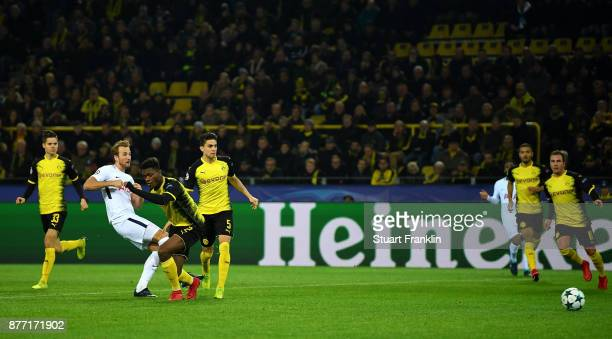 Harry Kane of Tottenham Hotspur scores his sides first goal during the UEFA Champions League group H match between Borussia Dortmund and Tottenham...