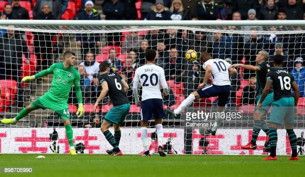 Harry Kane of Tottenham Hotspur scores his sides first goal during the Premier League match between Tottenham Hotspur and Southampton at Wembley...