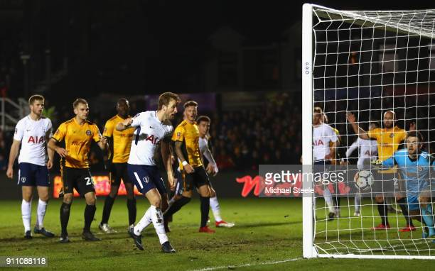 Harry Kane of Tottenham Hotspur scores his sides first goal during The Emirates FA Cup Fourth Round match between Newport County and Tottenham...