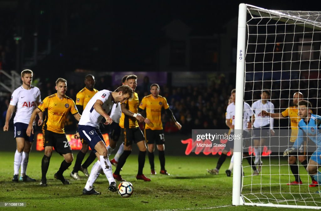 Harry Kane of Tottenham Hotspur scores his sides first goal during The Emirates FA Cup Fourth Round match between Newport County and Tottenham Hotspur at Rodney Parade on January 27, 2018 in Newport, Wales.