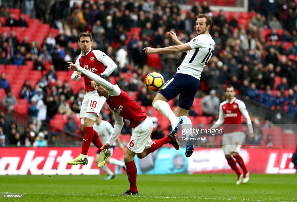 Harry Kane of Tottenham Hotspur scores his side's first goal during the Premier League match between Tottenham Hotspur and Arsenal at Wembley Stadium on February 10, 2018 in London, England.