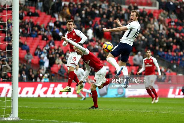 Harry Kane of Tottenham Hotspur scores his side's first goal during the Premier League match between Tottenham Hotspur and Arsenal at Wembley Stadium...