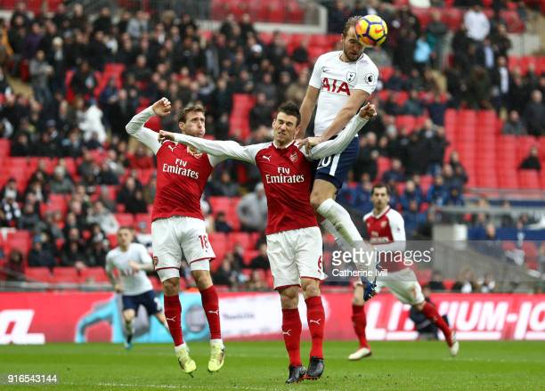 Harry Kane of Tottenham Hotspur scores his sides first goal during the Premier League match between Tottenham Hotspur and Arsenal at Wembley Stadium...